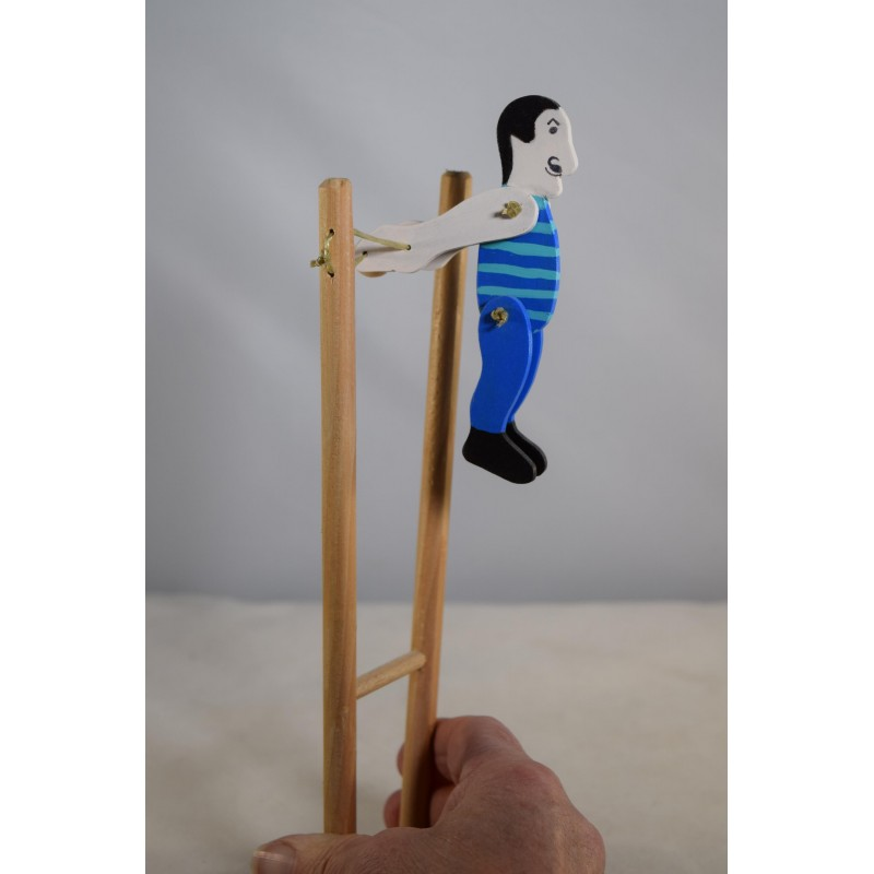 Wooden colourful acrobat doll