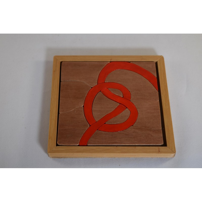 Wooden Puzzle with Heart-Shaped Bow in a Frame